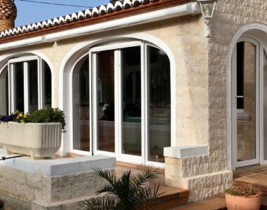 French doors in arched frame